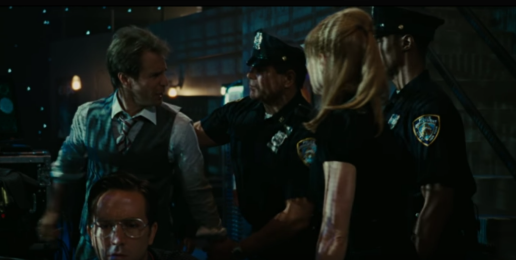 Middlebrook, center, handcuffing Sam Rockwell, in Iron Man 2.